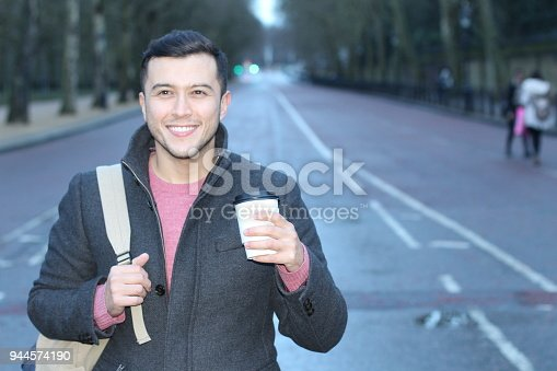 868483314 istock photo Joyful man starting the day with coffee 944574190