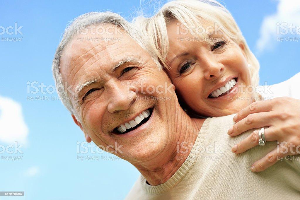 Joyful mature couple enjoying each other royalty-free stock photo