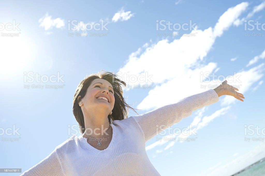 Joyful mature woman smiling stock photo