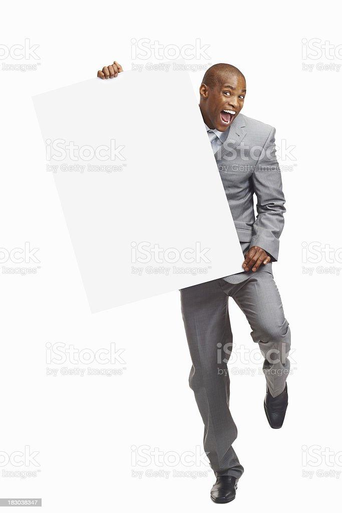 Joyful middle aged business man holding billboard against white background royalty-free stock photo