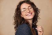 istock Joyful natural young woman smiling 1289220974