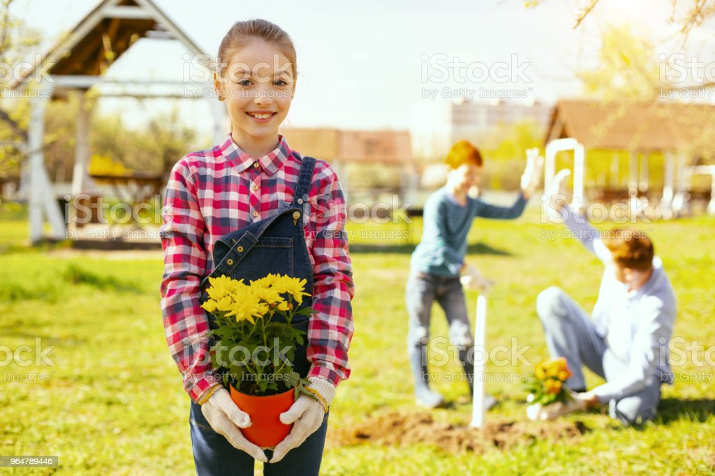 Joyful nice girl standing in the garden royalty-free stock photo