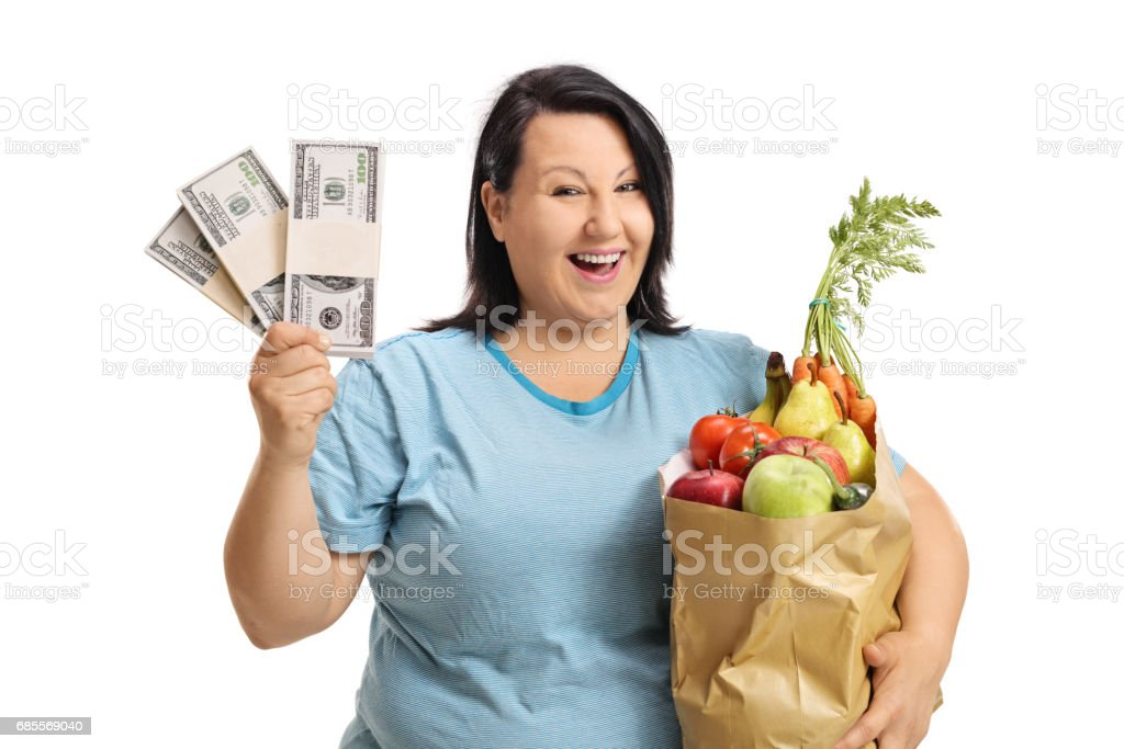Joyful overweight woman with bundles of money and bag royalty-free 스톡 사진