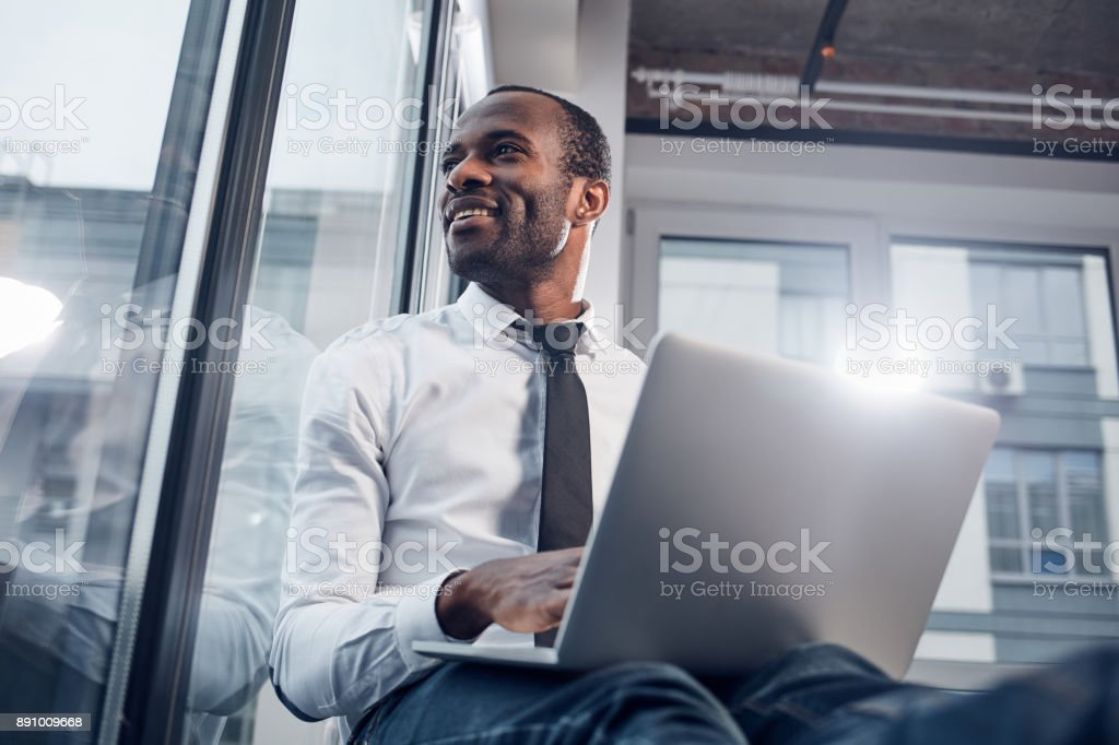 Joyful pleasant businessman is enjoying city landscape stock photo