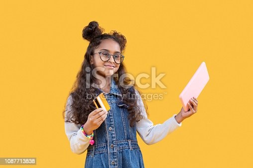 Electronic banking. Joyful positive girl making an online payment while using a credit card