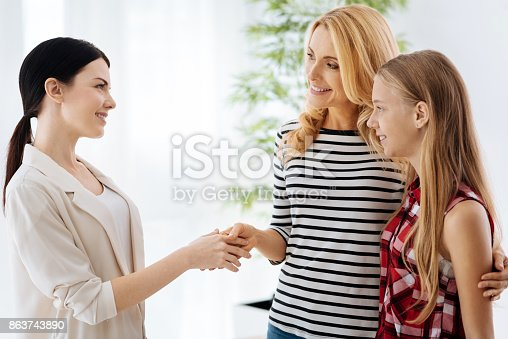 istock Joyful positive woman being grateful to the therapist 863743890