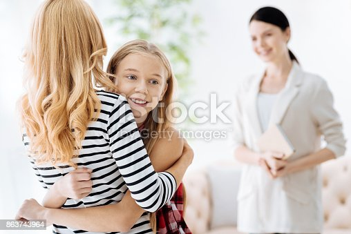istock Joyful pretty girl hugging her mother 863743964