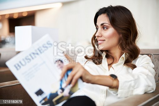 Beautiful young woman with book looking away and smiling stock photo