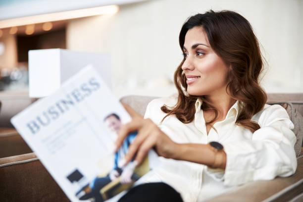 Joyful pretty lady holding book about business stock photo