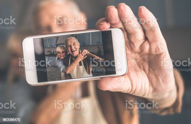 Joyful senior married couple photographing themselves on smartph picture id962066470?b=1&k=6&m=962066470&s=612x612&h=x19smdyweqz24htbeudbgjm9qxjile3wqal ogwlrqq=