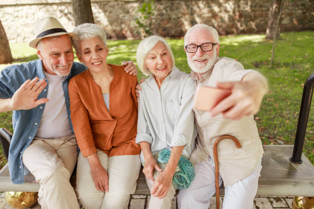 Joyful senior people making selfie on the street stock photo