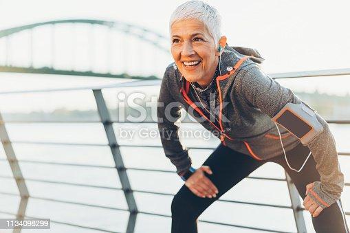 istock Joyful senior woman stretching 1134098299