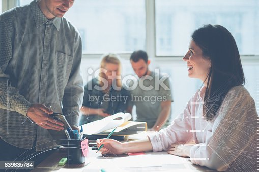 639637280istockphoto Joyful team brainstorming. New marketing plan researching 639635784
