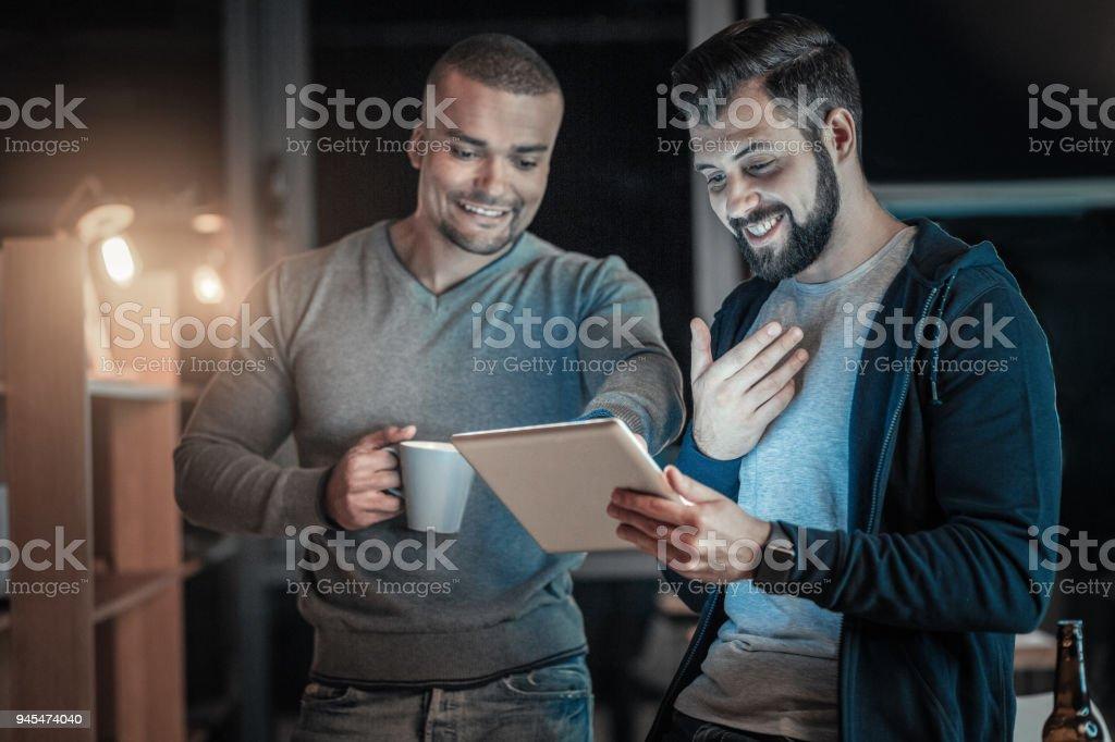 Joyful two colleagues perfecting code stock photo