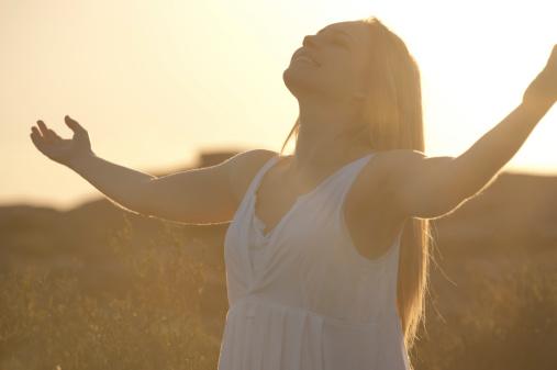 istock Joyful woman at sunrise 186876937