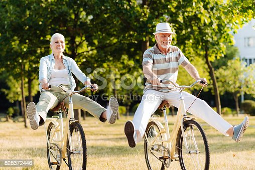 istock Joyful woman feeling happiness while cycling 828372446