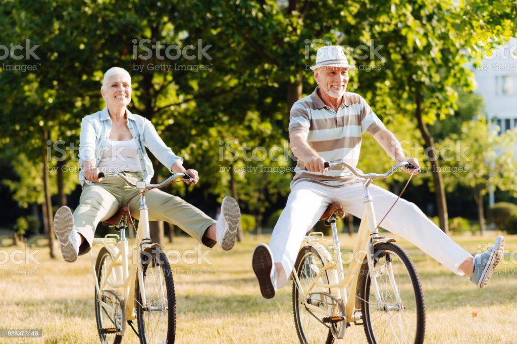 Joyful woman feeling happiness while cycling stock photo
