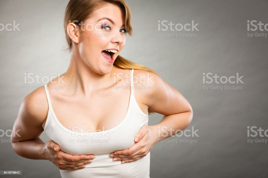 Joyful woman holding hands on her breast stock photo