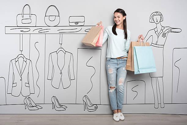 joyful woman posing after shopping - damen jeans sale stock-fotos und bilder