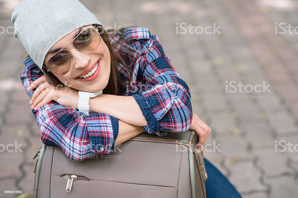 Joyful woman relaxing near baggage royalty-free stock photo