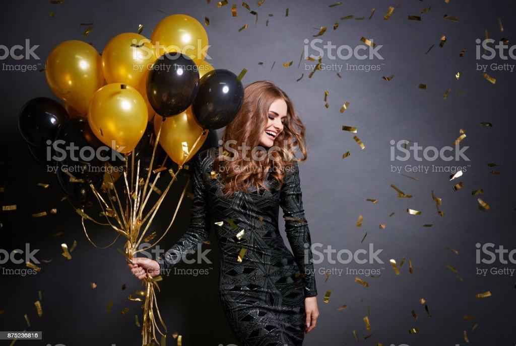 Joyful woman with bunch of balloons stock photo