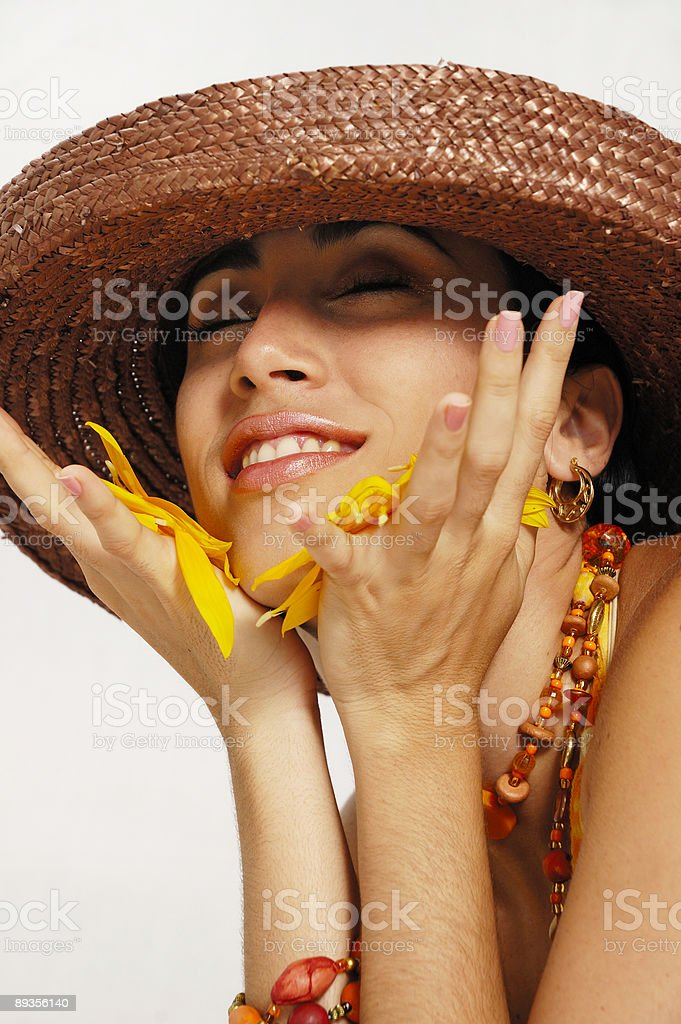 Joyful woman with flower petals royalty free stockfoto