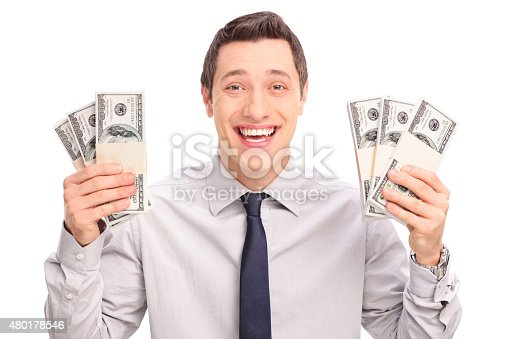 istock Joyful young man holding six stacks of money 480178546