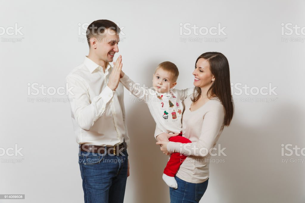 4f3ce72b Joyful young man, woman holding, hugging little cute child boy, giving five  gesture isolated on white background. Father, mother, little kid son.