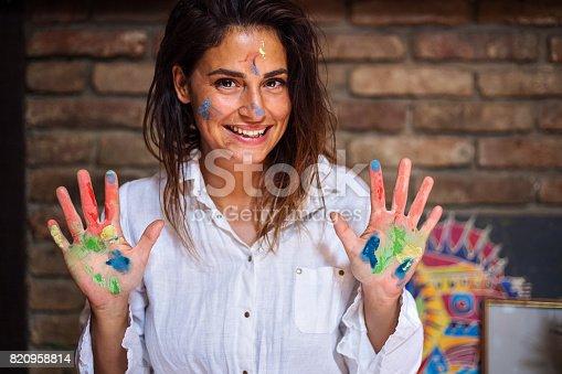 istock Joyful young painter woman 820958814