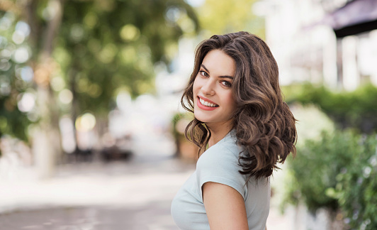 Smiling girl portrait in a city. People, summer fun, enjoy life concept