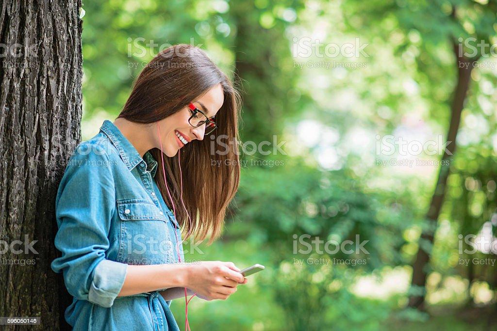 Joyful young woman relaxing in nature royalty-free stock photo