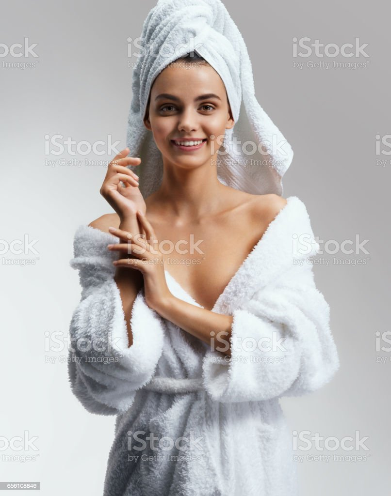 Joyous attractive girl in white bathrobe after spa. – Foto