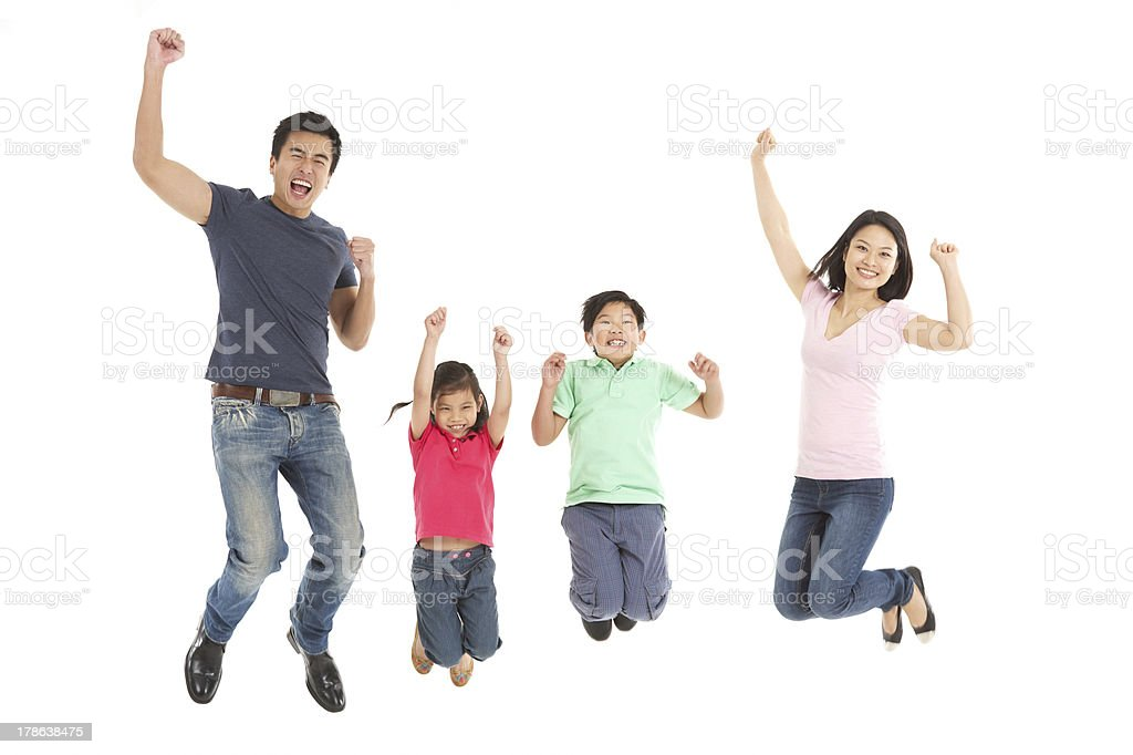 A joyous Chinese family jumping high and smiling stock photo