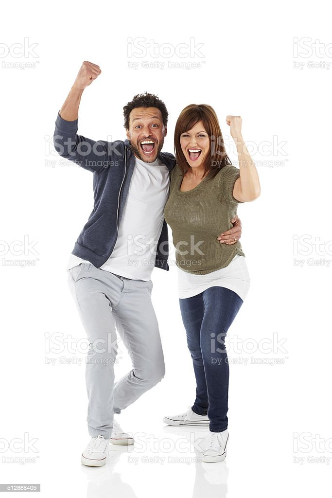 Joyous mature couple celebrating success stock photo