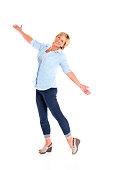istock Joyous mature woman standing on white 186774181