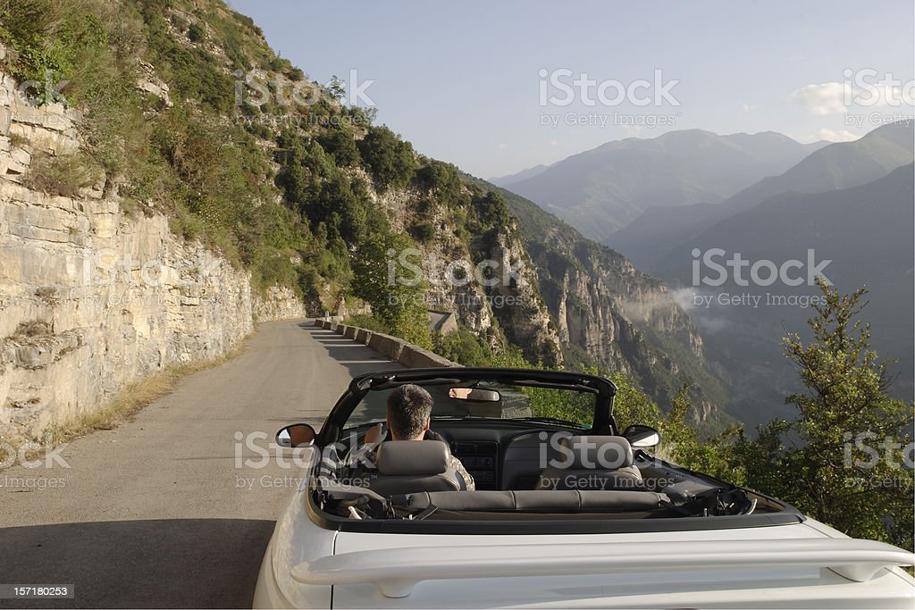 Joyride: driving an open convertible in the French Alps-Maritimes stock photo