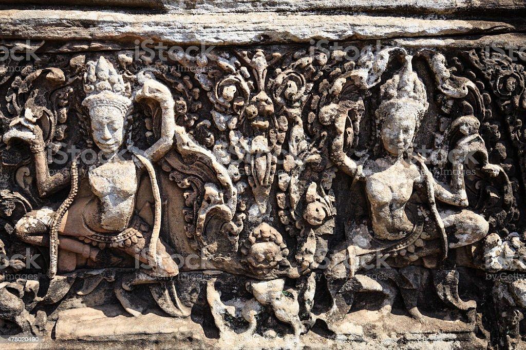 Joys of Dacing Apsara in Bayon Temple stock photo