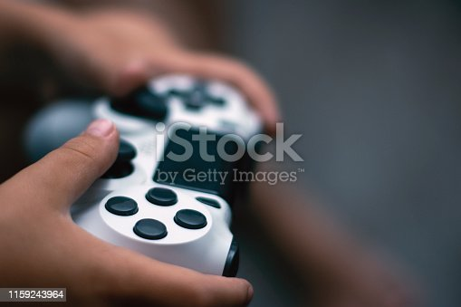 Joystick in game. Close-up of hands holding gamepad. Games concept.