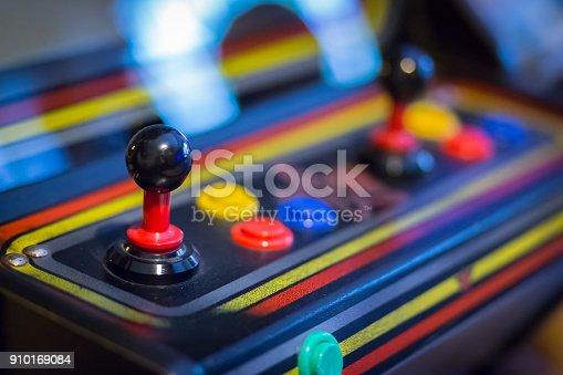 istock Joystick of a vintage arcade videogame - Coin-Op 910169084