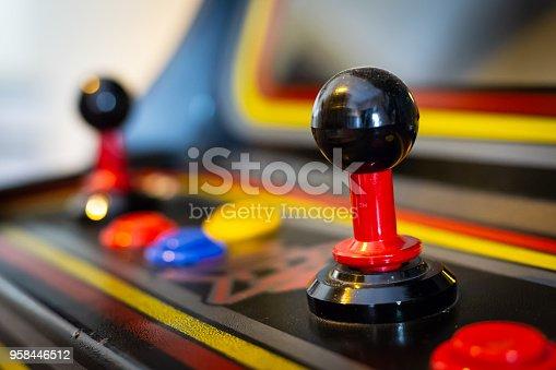 istock Joystick of a vintage arcade videogame - Coin-Op 958446512