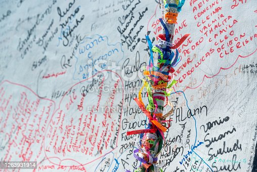 Juazeiro do Norte, Ceara, Brazil. Ribbons that the pilgrims hang and personal names that they write on the base of the statue of Padre Cicero.