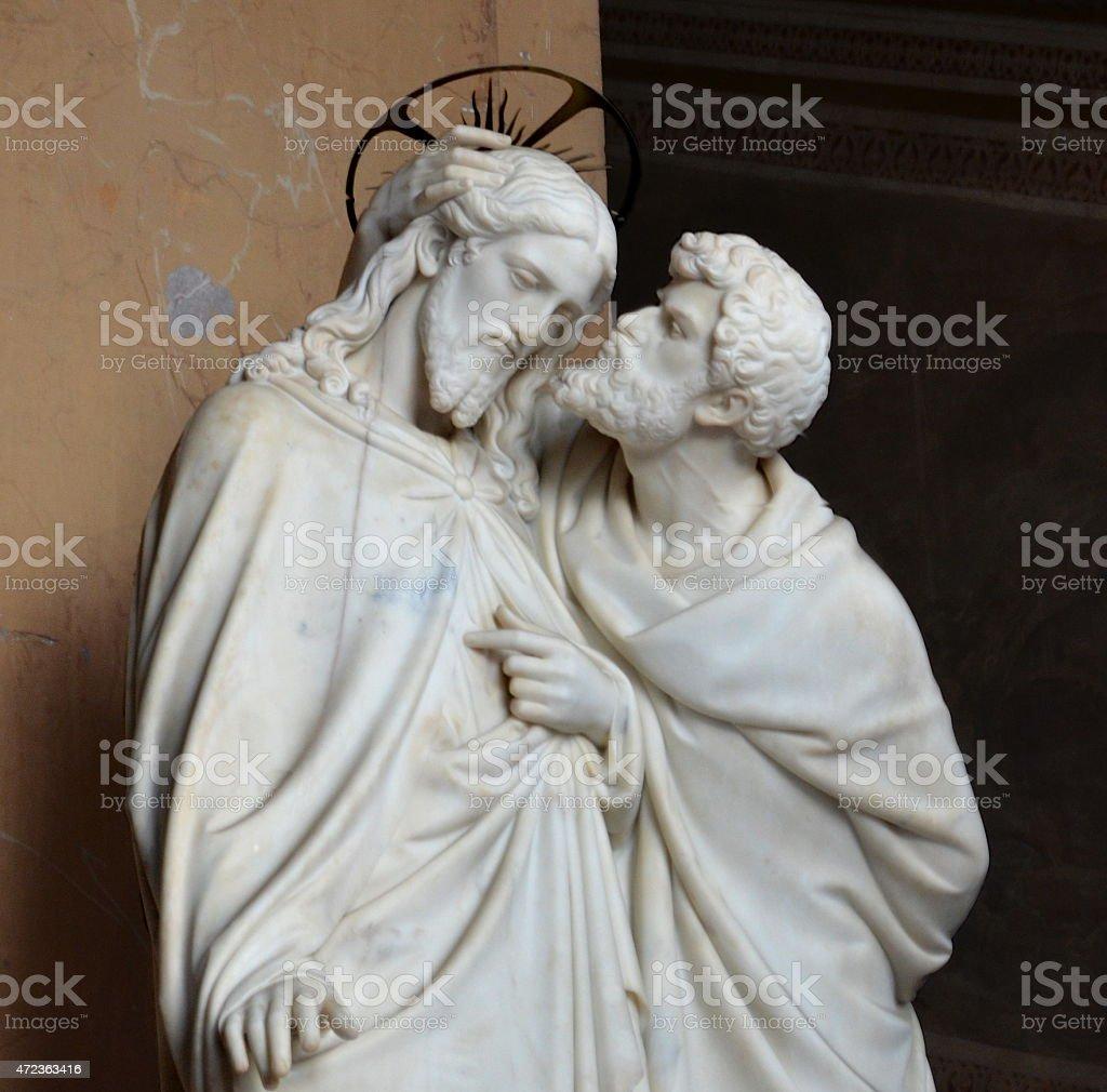 Judas kissing Jesus stock photo