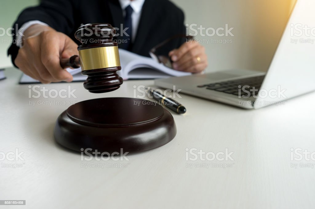 Judge adjudicate in courtroom Referee hammer the gavel - Royalty-free Agreement Stock Photo
