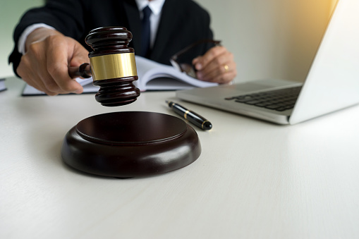 Judge Adjudicate In Courtroom Referee Hammer The Gavel Stock Photo - Download Image Now
