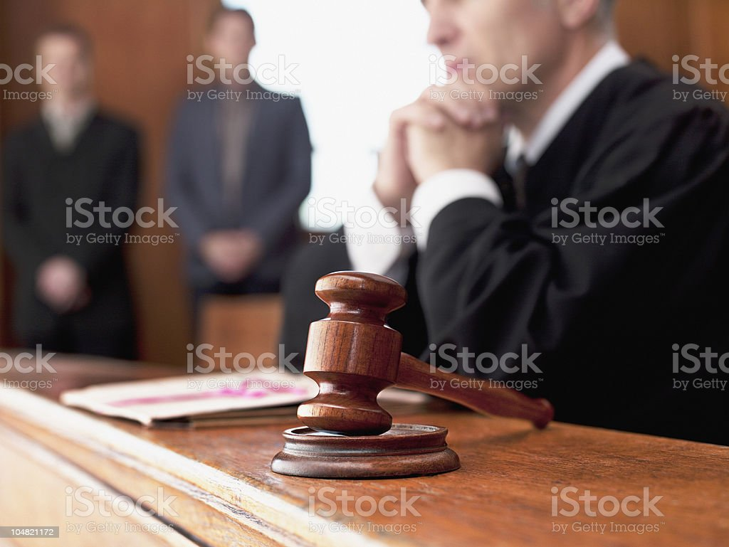 Judge and gavel in courtroom stock photo
