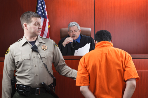istock Judge and Prisoner in Courtroom 137340116