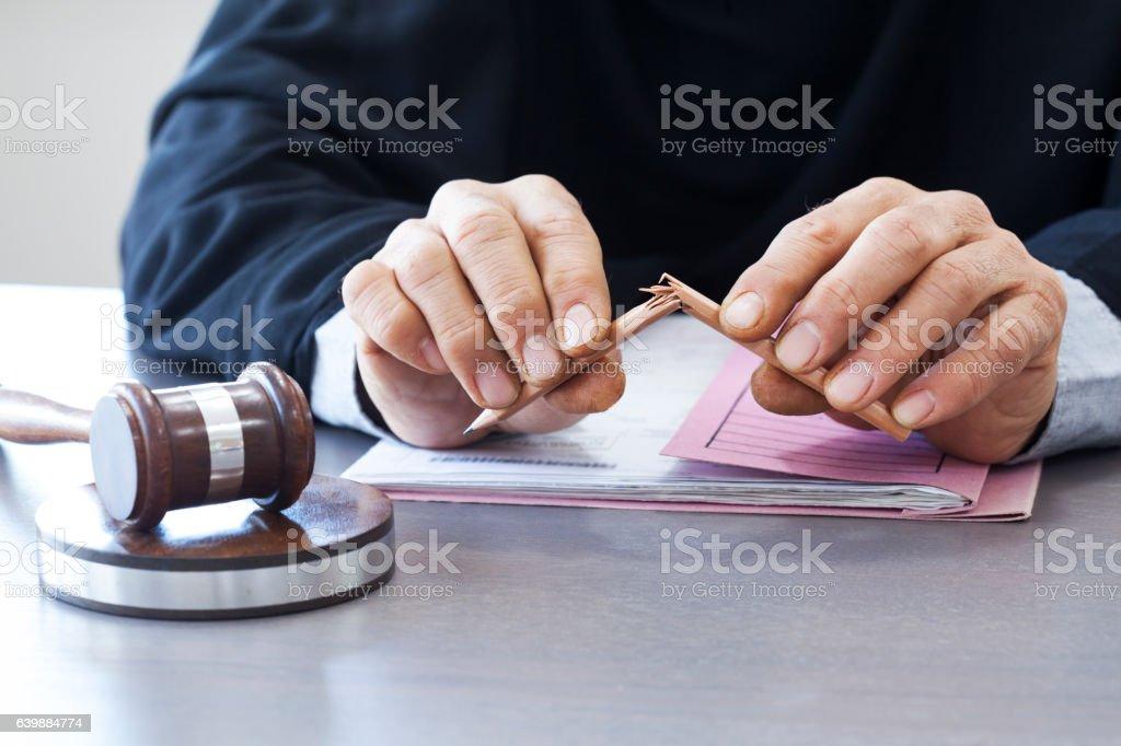 Judge break pencil with gavel stock photo