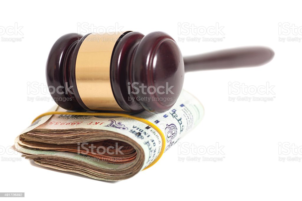 Judge gavel and Indian Currency Rupee bank notes stock photo