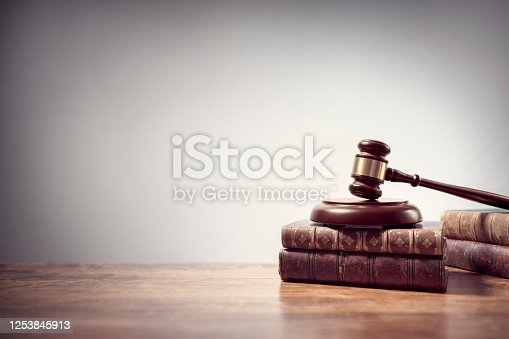 1070981872 istock photo Judge gavel and law books in court background with copy space 1253845913