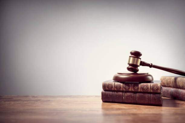 Judge gavel and law books in court background with copy space stock photo